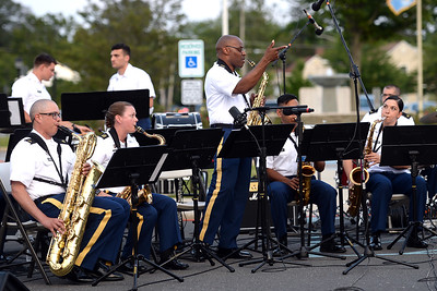 Sgt. Ishuann Dixon of the 63RD Army Band directs the Dance Band portion of the open air concert at Squan Plaza, in Manasquan, NJ on 06/28/2019. (STEVE WEXLER/THE COAST STAR).