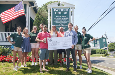 Shane Matthews [in red] and Spencer Munson [in plaid] with the Parker house staff. The Parker House check presentation to Spencer Munson of Clean Ocean Action in Sea Girt, NJ on 7/11/19. [DANIELLA HEMINGHAUS]