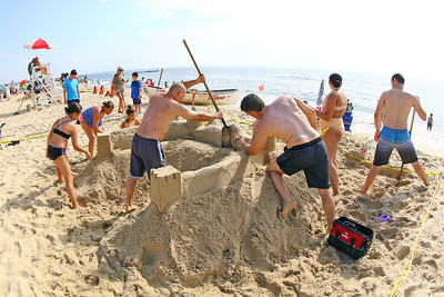 Team Guarrera of Old Bridge work together on their sand sculpture during the 33rd annual New Jersey Sandcastle Contest was held at the 18th Ave beach in Belmar on Wednesday July 17, 2019. (MARK R. SULLiVAN/ THE COAST STAR)
