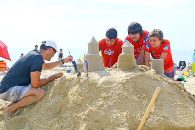 Team Millones from Montreal Canada work on their sand sculpture during the 33rd annual New Jersey Sandcastle Contest was held at the 18th Ave beach in Belmar on Wednesday July 17, 2019. (MARK R. SULLiVAN/ THE COAST STAR)