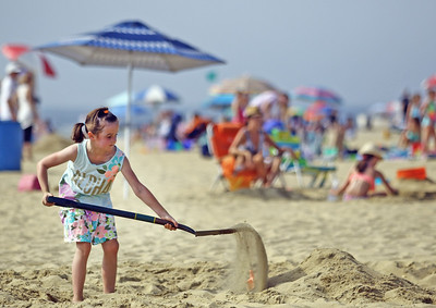 Regan Matunas starts work on the Spring Lake Recreation sculpture during the  33rd annual New Jersey Sandcastle Contest was held at the 18th Ave beach in Belmar on Wednesday July 17, 2019. (MARK R. SULLiVAN/ THE COAST STAR)