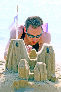 Micheal Cooper of Clifton works on the details of his sand sculpture during the 33rd annual New Jersey Sandcastle Contest was held at the 18th Ave beach in Belmar on Wednesday July 17, 2019. (MARK R. SULLiVAN/ THE COAST STAR)