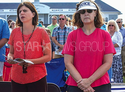 l-r: rosanna ayers of belmar and dianne duffy of sea girt during the mass.