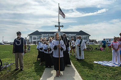 alter boys and girls of saint rose in belmar lining up before the bishop.