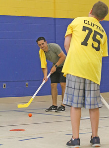 Connor Clifton [left] playing hockey with the kids. Boston Bruins player Connor Clifton visits the AMP fitness in Manasquan, NJ on 8/14/19. [DANIELLA HEMINGHAUS]