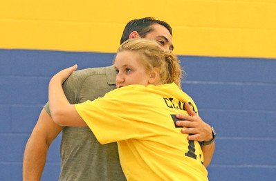 Connor Clifton [left] hugging Shae Callahan, from Brielle. Boston Bruins player Connor Clifton visits the AMP fitness in Manasquan, NJ on 8/14/19. [DANIELLA HEMINGHAUS]