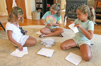 [l-r]: Charlize, Eva, and Fiona Shaughnessy helping out. The Sea Girt Community Appeal's envelope stuffing in Sea Girt,  NJ on 8/22/19. [DANIELLA HEMINGHAUS]