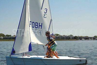 raul gregory and arely rubio of bradley beach sailing a hartley