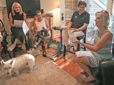 [L-R]: MariAnn Weinberg, from neptune; Kathy Levy, from Spring Lake; Liz Bogardus, from Lakewood; and Joanne Lackett, from Brielle with Bernie the dog. A book club meeting in Wall, NJ on 8/29/19. [DANIELLA HEMINGHAUS]