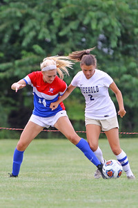Katelyn Mish (left)  battles with a Freehold Boro defender as Wall Township High School hosted Freehold Borough in a girls varsity soccer match on Thursday Sept. 5, 2019  (MARK R. SULLIVAN THE COAST STAR)