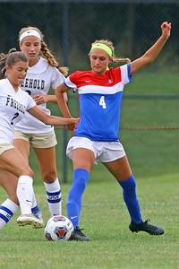 Olivia Ramiz battles with a Freehold Boro defender as Wall Township High School hosted Freehold Borough in a girls varsity soccer match on Thursday Sept. 5, 2019  (MARK R. SULLIVAN THE COAST STAR)