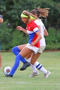Olivia Ramiz of Wall battles with a Freehold Boro defender as Wall Township High School hosted Freehold Borough in a girls varsity soccer match on Thursday Sept. 5, 2019  (MARK R. SULLIVAN THE COAST STAR)