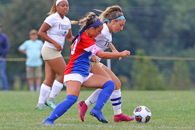 Marissa Sciorilli (left) battles with a Freehold Boro defender as Wall Township High School hosted Freehold Borough in a girls varsity soccer match on Thursday Sept. 5, 2019  (MARK R. SULLIVAN THE COAST STAR)