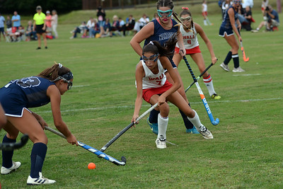 Sydney Yodh #7 of the Wall High School Girl's Field Hockey Team works the ball around several Manasquan Warrior players in the game played at Wall High School, Wall Township, NJ on 09/05/2019. (STEVE WEXLER/THE COAST STAR).