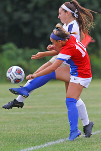 Marissa Sciorilli bates with a Freehold Boro defender as Wall Township High School hosted Freehold Borough in a girls varsity soccer match on Thursday Sept. 5, 2019  (MARK R. SULLIVAN THE COAST STAR)