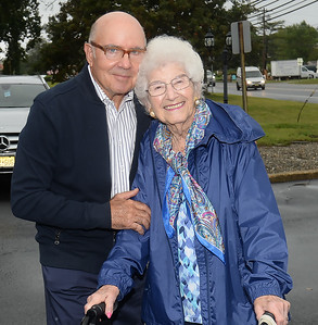 WALL ALL IN THE FAMILY DENTAL CARE 85TH ANNIVERSARY DR TOM CAMPI WITH BESS PETERSON OF BRADLEY BEACH. BESS WAS THE FIRST PATIENT AT THE DENTAL PRACTICE WHEN IT OPENED. 09/11/2018. (STEVE WEXLER/THE COAST STAR).