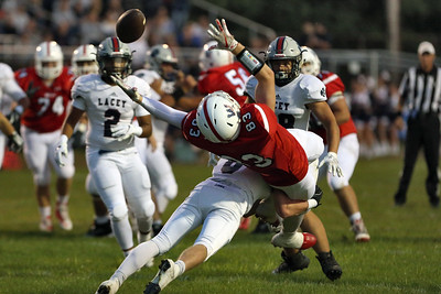 Tanner Powers from Wall is upended as he reaches for a pass as Wall Township High School takes on Lacey High School in a boys varsity football game held in Wall on Friday September 21, 2018. (MARK R. SULLIVAN /THE COAST STAR)
