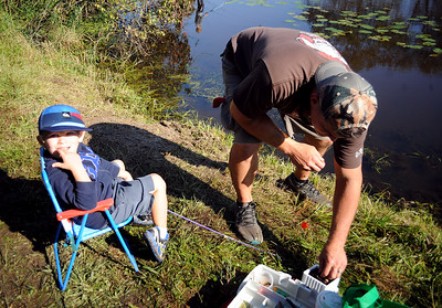 LUKE STOPORA AGE 3 LETS DAD KEITH STOPORA SET UP HIS FISHING RIG AT THE WALL KIDS FISHING DERBY HELD IN WALL, NEW JERSEY ON 09/29/2018. (STEVE WEXLER/THE COAST STAR).