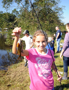 AMELIA AUCH AGE 9 OF WALL, NEW JERSEY PROUDLY DISPLAYS HER  CATCH AT THE WALL KIDS FISHING DERBY HELD ON 09/29/2018. (STEVE WEXLER/THE COAST STAR).