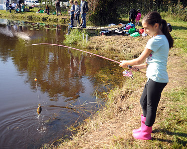 EMMA IDZAHL, AGE 10 OF WALL, NEW JERSEY REELS IN HER CATCH AT THE WALL KIDS FISHING DERBY HELD IN WALL TOWNSHIP, NEW JERSEY ON 09/29/2018. (STEVE WEXLER/THE COAST STAR).