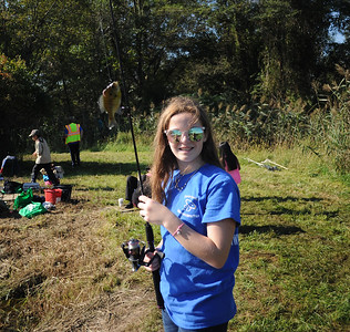 TIERNEY CONNERS OF WALL, NEW JERSEY DISPLAYS HER FRESHLY CAUGHT FISH WHILE PARTICIPATING IN THE WALL KIDS FISHING DERBY HELD IN WALL TOWNSHIP, NEW JERSEY ON 09/29/2018. (STEVE WEXLER/THE COAST STAR).