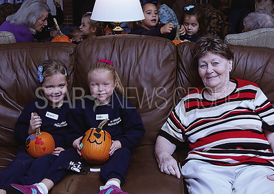 St Catherines Pre-k Pumpkin painting at the Arbors// Brynn Clark and Addie Hayes with Sally Cullen
