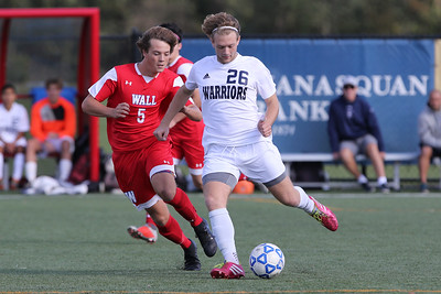 Drew Greenblatt (right) from Manasquan battles with Tagg Ancrum (left) from Wall as Wall Township High School hosted Manasquan High School in a boys varsity soccer game held on Wednesday October 17, 2018.  (MARK R. SULLIVAN/THE COAST STAR)
