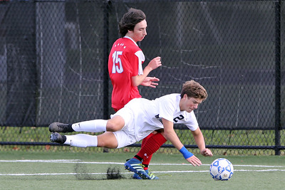 Sam See Guercio (lower) from Manasquan hits the turf as Wall's Riley Powers asWall Township High School hosted Manasquan High School in a boys varsity soccer game held on Wednesday October 17, 2018.  (MARK R. SULLIVAN/THE COAST STAR)