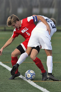 Jeff Burdge (left) from Wall battles with Manasquan's Tommy Johnson as Wall Township High School hosted Manasquan High School in a boys varsity soccer game held on Wednesday October 17, 2018.  (MARK R. SULLIVAN/THE COAST STAR)