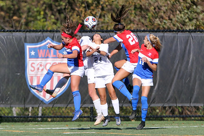 Kiera Higgins (center) from Manasquan gets her head on the ball while battling Wall defenders as Wall Township High School hosted Manasquan High School during the Girls 2018 NJSIAA Central, Group 2 Tournament held in Wall Township on Tuesday October 30, 2018. (MARK R. SULLIVAN/THE COAST STAR)