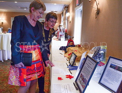 dianne lippert of sea girt [left] and starr wheeler of brick, checking out the silent auction prizes. both are members of the ocean med guild.