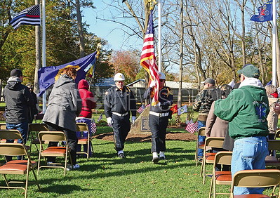 members of the slh american legion color guard presenting the flag