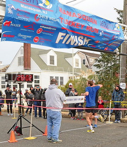 matt sampson. msq. crossing the finish line in 1rst place.