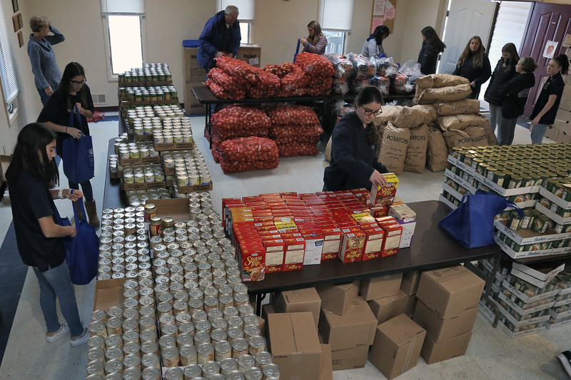 On Thursday November 15, 2018 volunteers and 7th and 8th grade students from Avon Elementary School were on hand at the Bradley Beach Food Pantry to help unload trucks, pack shelves and fill bags to be given out for Thanksgiving.  (MARK R. SULLIVAN/THE COAST STAR)