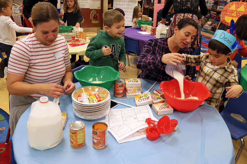 Katy Anzzolin (left) and her son Connor work along side Heather Scotto and her son Anthony as kindergarten students and their parents were on hand at Spring Lake Elementary School for a Thanksgiving no bake pumpkin pies on Thursday November 20,2018. (MARK R. SULLIVAN/THE COAST STAR)
