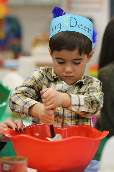 Anthony Scotto stirs the pie mix as kindergarten students and their parents were on hand at Spring Lake Elementary School for a Thanksgiving no bake pumpkin pies on Thursday November 20,2018. (MARK R. SULLIVAN/THE COAST STAR)