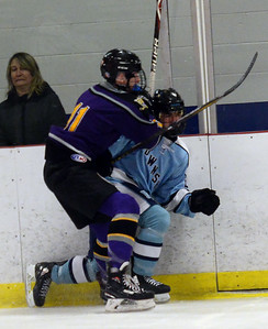 #11, SEAN GRANT OF THE ST ROSE VARSITY ICE HOCKEY TEAM CHECKS A FREEHOLD TOWNSHIP HIGH SCHOOL PLAYER AGAINST THE BOARDS JUST AFTER THE START OF THE GAME PLAYED AT THE HOWELL ICE HOCKEY ARENA ON 11/26/2018. (STEVE WEXLER/THE COAST STAR).