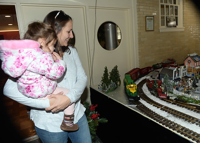 ANNE MCDONALD AGE 2 AND HER MOM PAM OF BRIELLE, NEW JERSEY VISITED THE ANNUAL CHRISTMAS VILLAGE AND MODEL TRAIN DISPLAY AT DUGGAN HALL IN SPRING LAKE, NEW JERSEY ON 11/24/2018. (STEVE WEXLER/THE COAST STAR).