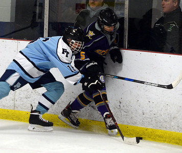 #5, RANDON SHAPIRO OF THE ST ROSE HIGH SCHOOL VARSITY ICE HOCKEY TEAM FIGHTS FOR THE PUCK AGAINST A FREEHOLD TOWNSHIP HIGH SCHOOL PLAYER DURING THEIR VGAME PLAYEDV AT THE HOWELL ICE SKATING ARENA ON 11/26/2018. (STEVE WEXLER/THE COAST STAR).