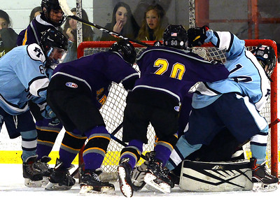 A MAD SCRAMBLE AND PILE UP AT THE FREEHOLD TOWNSHIP GOAL AS ST ROSE VARSITY ICE HOCKEY PLAYER TRY TO GET THE PUCK IN DURING THE GAME BETWEEN ST RTOSE HIGH SCHOOL AND FREEHOLD TOWNSHIP HIGH SCHOOL ON 11/26/2018. (STEVE WEXLER/THE COAST STAR).