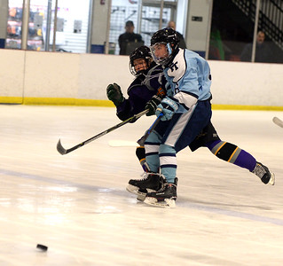 A ST ROSE VARSITY HOCKEY PLAYER PASSES THE PUCK UP INTO FREEHOLD TOWNSHIP TERRITORY NEAR THE START OF THE GAME PLAYED ON 11/26/2018. (STEVE WEXLER/THE COAST STAR).