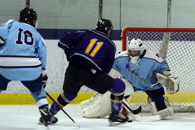 ST ROSE HIGH SCHOOL VARSITY HOCKEY PLAYER #11, SEAN GRANT TAKES A SHOT AT THE FREEHOLD TOWNSHIP HIGH SCHOOL GOAL IN THEIR GAME PLAYED AT THE HOWELL ICE SKATING ARENA ON 11/26/2018. (STEVE WEXLER/THE COAST STAR).