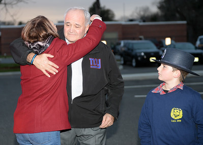 Dona Palmer, wife of Chief Michael Palmer, Brielle Boro Police Department, Brielle, New Jersey, hugs him during a final salute ceremony honoring Chief Palmer's 38 years of service with the Boro as his Grandson Kevin looks on at Boro Hall on 11/30/2018. (STEVE WEXLER/THE COAST STAR).