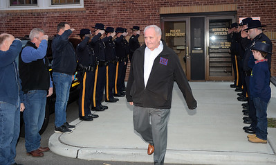 Chief Michael Palmer of the Brielle Boro Police Department walks out on his final day of a 38 year career to a salute from his staff in Brielle, New Jersey on 11/30/2018. (STEVE WEXLER/THE COAST STAR).
