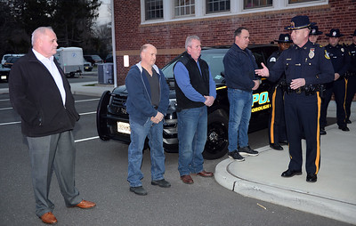Chief Michael Palmer of the Brielle Boro Police Department listens to comments made by Captain Gary Olsen after completing his last day on the job after 38 years and was honored by formal salute by his staff and a few retired officers on 11/30/2018. (STEVE WEXLER/THE COAST STAR).