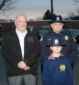 Chief Michael Palmer of the Brielle Boro Police Department, Brielle Boro, New Jersey, was honored with a Final Salute upon his retirement from service afyter 38 years and is seen here with his son Michael and Grandson Kevin on 11/30/2018. (STEVE WEXLER/THE COAST STAR).