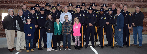 Chief Michael Palmer of the Brielle Boro Police Department, Brielle, New Jersey was honored on his last day of service after 38 years with a Final Salute and kind words. The Chief took a moment to take several photographs with his department, local goverment officials, family and friends, at Boro Hall on 11/30/2018. (STEVE WEXLER/THE COAST STAR).