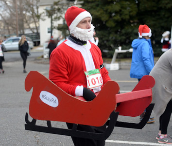 A wide variety of runners in various holiday costumes were seen at the Jingle Bell 5K Run, held at Bar Anticipation in Lake Como, New Jersey on 12/01/2018. (STEVE WEXLER/THE COAST STAR).