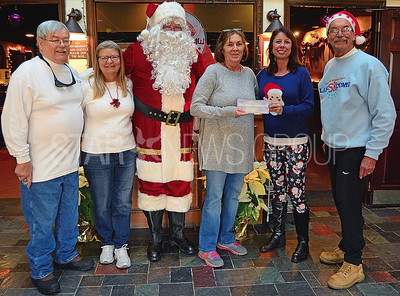 jerry franzee, carly dePolo [both : co-race directors], barabra mcCredier[sed special children chair], jim dugan[santa], melissa colvin, dave galzer[special needs chair @ the elks]. and the check