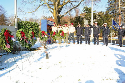 brl firemen and members of the boy scouts saluting the wreaths and monument